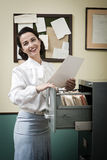 Cheerful secretary at work Royalty Free Stock Images