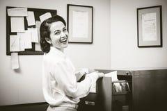 Cheerful secretary at work Stock Photo