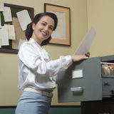 Cheerful secretary at work Royalty Free Stock Image