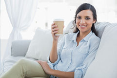 Cheerful seductive brunette having coffee Stock Images