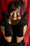 Cheerful seductive woman with black gloves Stock Photo
