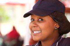 Cheerful seller portrait in uniform Stock Photography