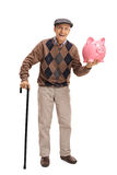 Cheerful senior with a cane and a piggybank. Full length portrait of a cheerful senior with a cane and a piggybank isolated on white background Royalty Free Stock Image