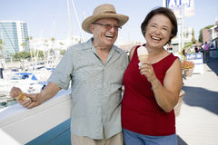 Cheerful Senior Caucasian Couple Holding Ice-creams Royalty Free Stock Photo