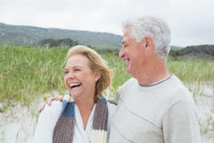 Cheerful senior couple at beach Stock Photo