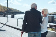Cheerful senior couple chatting during promenade Stock Images