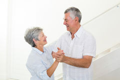 Cheerful senior couple dancing together Royalty Free Stock Image