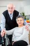 Cheerful senior couple embracing each other stock image