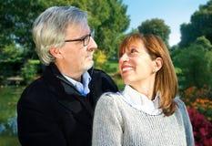Cheerful senior couple enjoying peaceful nature Stock Images