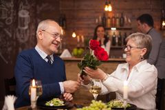 Cheerful senior couple happy about their date stock photo