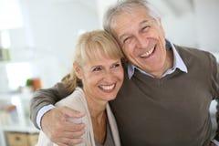 Cheerful senior couple laughing Stock Image