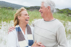 Cheerful senior couple looking at each other at beach Royalty Free Stock Photography