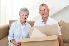 Cheerful senior couple moving into new home Stock Photos