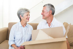 Cheerful senior couple moving into new home Stock Images