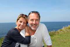 Cheerful senior couple by the seaside royalty free stock image