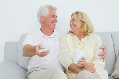 Cheerful senior couple watching television Stock Photography