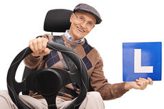Cheerful senior driver holding an L-sign Royalty Free Stock Photography