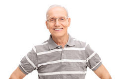 Cheerful senior gentleman in a gray polo shirt. Cheerful senior gentleman in a casual gray polo shirt, smiling and looking at the camera isolated on white Royalty Free Stock Images