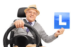 Cheerful senior gentleman holding an L-sign Royalty Free Stock Image