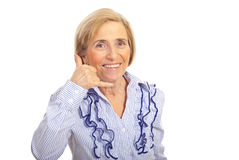 Cheerful senior gesturing call me. Cheerful senior woman gesturing with hand call me isolated on white background Stock Photography