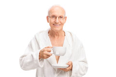 Cheerful senior holding a cup of tea Royalty Free Stock Photos