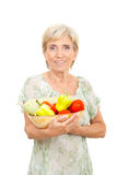 Cheerful senior holding fresh vegetables stock images