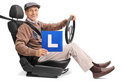 Cheerful senior holding an L-sign Stock Image