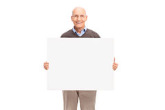 Cheerful senior holding a white signboard Stock Image