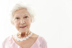 Cheerful senior lady with genuine smile Royalty Free Stock Image