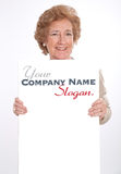 Cheerful senior lady holding a vertical blank board Stock Image