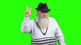 Cheerful senior man demonstrating victory sign. stock video footage