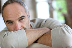 Cheerful senior man relaxing at home Stock Image