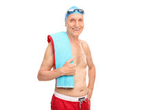 Cheerful senior man with a swimming cap and goggles. Looking at the camera and smiling isolated on white background royalty free stock image