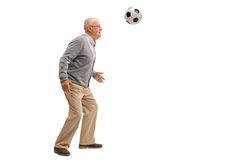 Cheerful senior playing with a football royalty free stock images