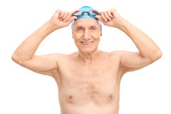 Cheerful senior putting on his swimming goggles Stock Image