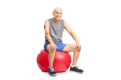 Cheerful senior sitting on a fitness ball Royalty Free Stock Photography