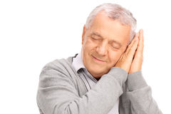 Cheerful senior sleeping on his hands and smiling Royalty Free Stock Images