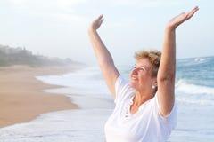 Cheerful senior woman. Happy cheerful senior woman on beach Stock Image