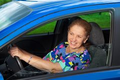 Cheerful senior woman driving Stock Photo