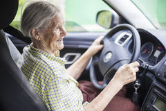 Cheerful senior woman driving a car Royalty Free Stock Photography