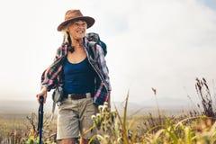 Cheerful senior woman enjoying her hiking trip royalty free stock images