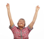 Cheerful senior woman gesturing victory over a white background Royalty Free Stock Photos
