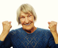 cheerful senior woman gesturing victory Stock Image