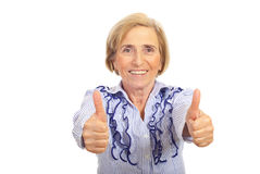 Cheerful senior woman giving thumbs up Royalty Free Stock Images