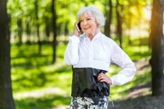 Cheerful senior woman having rest time during exercise outdoor Stock Photo