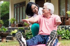 Cheerful senior woman helping her partner during workout session stock photos