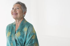 Cheerful Senior Woman Looking Up Stock Images