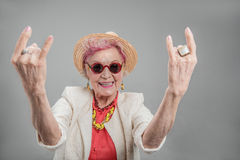 Cheerful senior woman posing in studio Royalty Free Stock Image