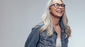 Cheerful senior woman in studio stock photo