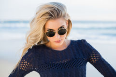 Cheerful sensual blonde looking over her sunglasses Stock Images